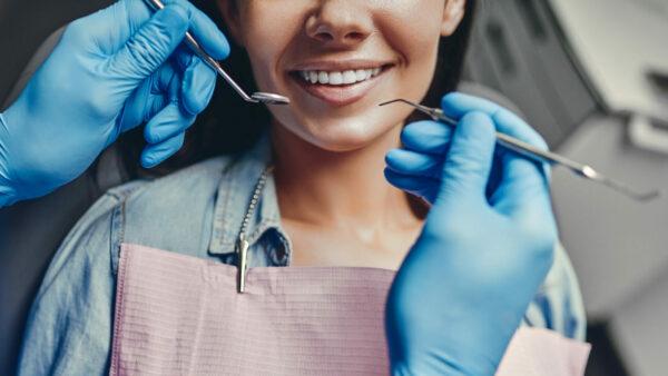 woman in dentist's chair cosmetic bonding